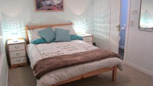 A bed or beds in a room at Little Haven