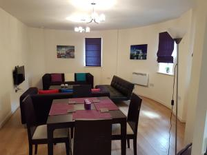 A restaurant or other place to eat at Apartment Town Centre - 2 bed, 2 bath