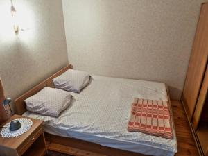 A bed or beds in a room at Brīviņi