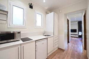 Køkken eller tekøkken på Apartamentos Atica