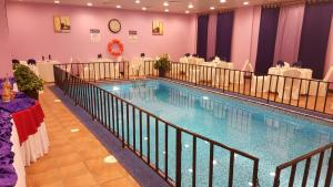 The swimming pool at or near Al Thuriah Hotel Apartment