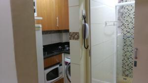 Kuchyň nebo kuchyňský kout v ubytování Copacabana Apartment
