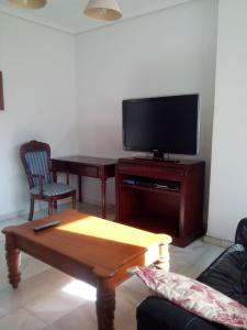 A television and/or entertainment center at casa chalet El Sotillo