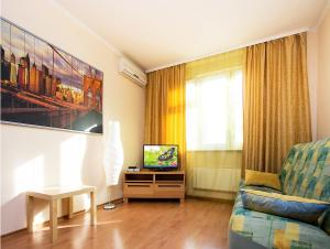 A television and/or entertainment center at ApartLux Yugo-Zapadnaya Superior