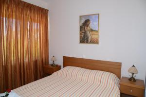 Ένα ή περισσότερα κρεβάτια σε δωμάτιο στο Maria's Filoxenia Suites