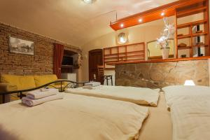 A bed or beds in a room at Central Apartment Studio