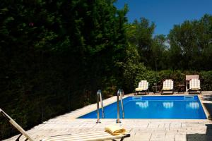 The swimming pool at or close to Anthemis Luxury Villas