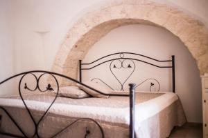Letto o letti in una camera di Residenze nei Trulli
