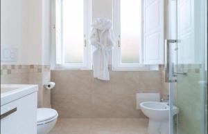 A bathroom at The villas apartment