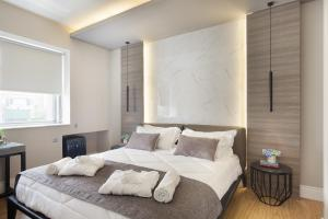 A bed or beds in a room at 47 Luxury Suites