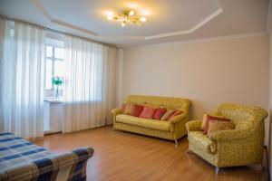 Гостиная зона в Apartment NG Na Chertygasheva