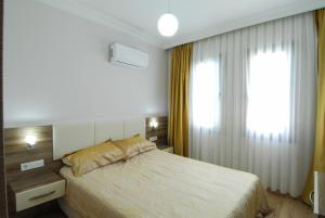 A bed or beds in a room at Burak Apart Hotel