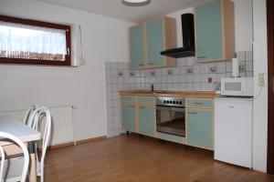 Virtuvė arba virtuvėlė apgyvendinimo įstaigoje Sunny House