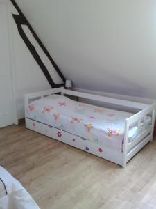 Un ou plusieurs lits dans un hébergement de l'établissement Gite De Malvoue