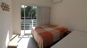 A bed or beds in a room at Vila Tiare Residencial
