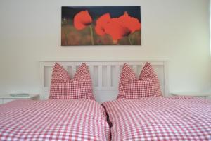 Ein Bett oder Betten in einem Zimmer der Unterkunft Feldmann-Schütte