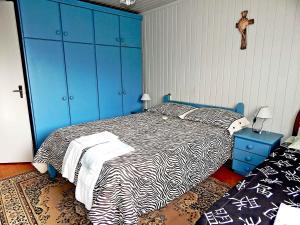 Cama ou camas em um quarto em Chale da Serra 02