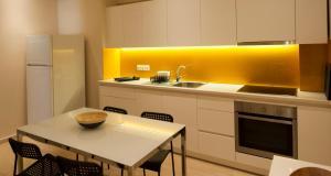 Een keuken of kitchenette bij Village