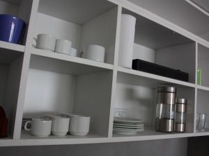 A kitchen or kitchenette at Paladium Suites