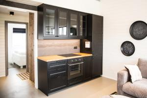 A kitchen or kitchenette at Gullfoss & Geysir Luxury Cabin