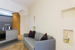 A seating area at Maison Laghetto - Apartment Suite