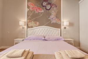 Cama ou camas em um quarto em Boschetto 124 Apartment