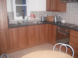 A kitchen or kitchenette at The Blue House Apartments