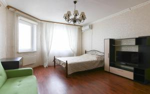 A bed or beds in a room at DearHome Maykla Lunnа