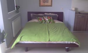 Een bed of bedden in een kamer bij Apartament Juventini PT