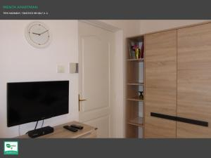 A television and/or entertainment centre at Menta Apartman