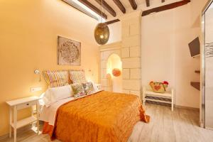 A bed or beds in a room at Remolars3 Townhouse - Turismo de Interior