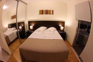 Una cama o camas en una habitación de Lecer
