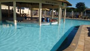 The swimming pool at or near Apartamento Lacqua Diroma