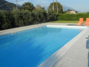 The swimming pool at or close to Villa Giardino Ulivo