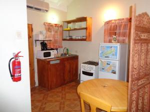 A kitchen or kitchenette at Ann's Villa