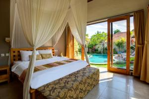 A bed or beds in a room at The Pandan Tree Villas