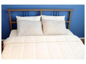 Кровать или кровати в номере Rakhmaninov