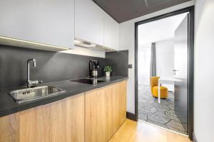 A kitchen or kitchenette at Appart'City Confort Nimes Arenes