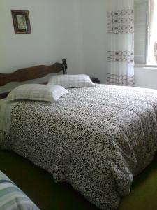Una cama o camas en una habitación de Estalagem Colling
