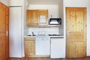 Virtuvė arba virtuvėlė apgyvendinimo įstaigoje Résidence Odalys Le Buet