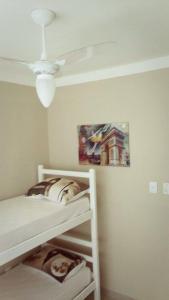 A bunk bed or bunk beds in a room at Apartamento Balneário Camboriú