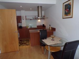 A kitchen or kitchenette at City Centre Suites