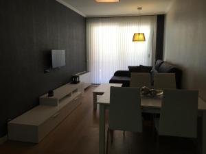 A seating area at Apartamento Mauricio Legendre 16