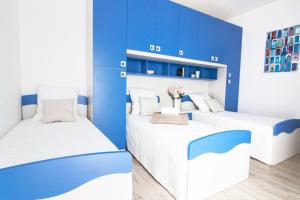 A bed or beds in a room at Alessia's Flat - Veneziano