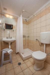 Vonios kambarys apgyvendinimo įstaigoje Skevoulis Studios