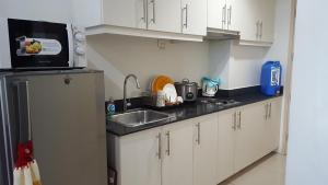 A kitchen or kitchenette at CNholy Condo