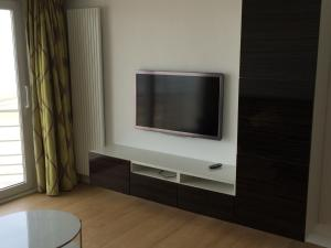 A television and/or entertainment center at Splendid 0705