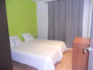 A bed or beds in a room at Apartamentos Rio de la Plata