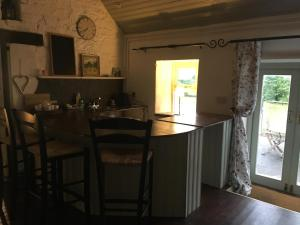A restaurant or other place to eat at Kilshanny Milk Parlour Cottage