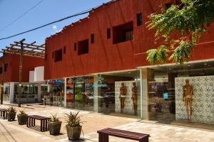 Uma varanda ou outra área externa em Vila da Pipa Suítes